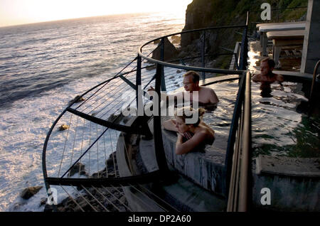 May 24, 2006; Sacramento, CA, USA; Visitors relax in the natural hot spring baths at Esalen Institute in Big Sur - Stock Photo