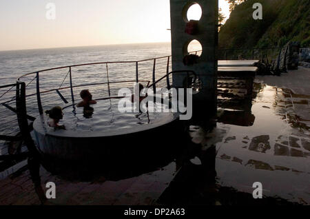 May 24, 2006; Sacramento, CA, USA; Visitors relax in the natural hot baths at Esalen Institute in Big Sur, Wednesday, - Stock Photo