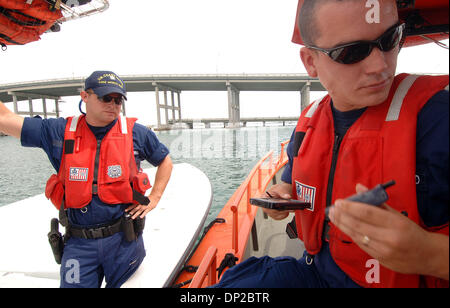 May 26, 2006; Riviera Beach, FL, USA; Coast Guard BM3 Chris Stover, 23, of Palm Beach Gardens radio's in information - Stock Photo