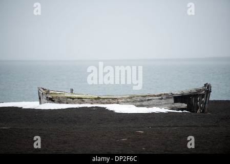 ANTARCTICA - A wooden whaling boat sits on the beach at Whalers Bay on Deception Island. A whaling station once - Stock Photo
