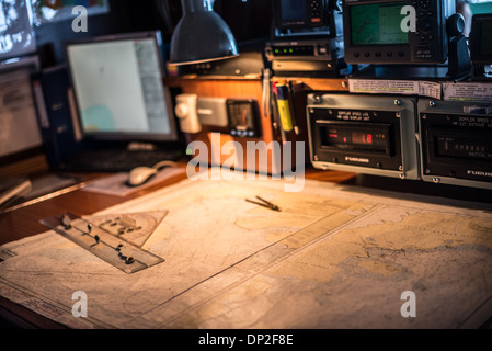 ANTARCTICA - Navigation charts on a map table on the bridge of an Antarctic cruise ship, the Polar Pioneer. - Stock Photo