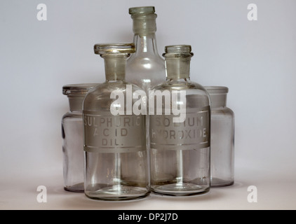 old chemistry bottle labeled for Sulphuric Acid Diluted and Sodium Hydroxide - Stock Photo