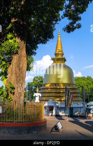 Asia Sri Lanka, Dambulla, a stupa at the entrance of the Golden Temple - Stock Photo