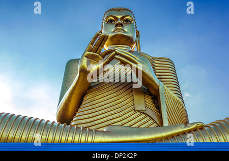 Asia Sri Lanka, Dambulla, detail of the large Buddha statue at the entrance of the Golden Temple - Stock Photo