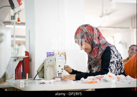 EGYPT, BELBEIS: Many young women work at Naturetex factory at SEKEM. Often they stop working when they get married. - Stock Photo