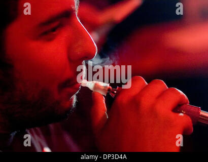 Jun 29, 2006; Sacramento, CA, USA; Digno Espinosa Frances puffs on a hookah with friends at Kasbah Lounge in Sacramento - Stock Photo