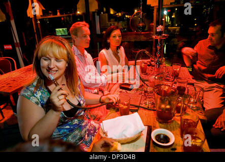 Jun 29, 2006; Sacramento, CA, USA; Jen Waldhaus left, enjoys a hookah with friends Michael Spranger  his wife Carmen - Stock Photo