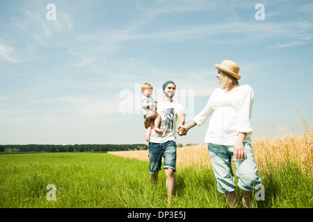 Family Walking by Agricultural Field, Mannheim, Baden-Wurttemberg, Germany - Stock Photo