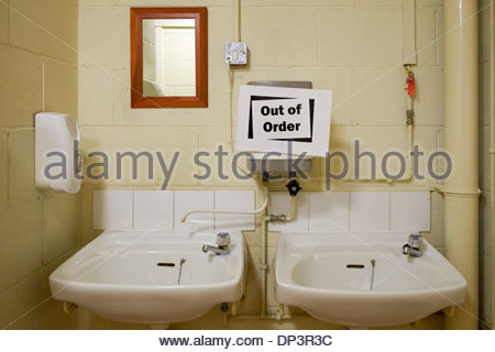 out of order sign on hot water heater above washbasins in toilet restroom bathroom - Bathroom Out Of Order
