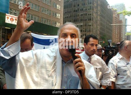 Jul 16, 2006; Manhattan, NY, USA; Rabbi AVI WEISS speaks as Congressman Anthony Weiner (R) looks on as dozens of - Stock Photo