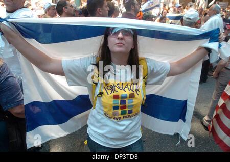 Jul 16, 2006; Manhattan, NY, USA; SHARON WEISS of East Meadow, Long Island wraps herself in an Israeli flag as dozens - Stock Photo