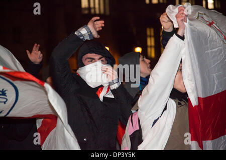 EDL supporters chanting and carrying red and white flags.  Approximately 50 English Defence League supporters protested - Stock Photo