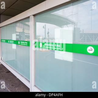 Airport smoking area - Stock Photo