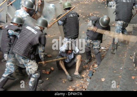 Apr 11, 2006; Kathmandu, NEPAL; Nepali People in Democracy Movement: Armed Police brutally beating a demonstrator - Stock Photo