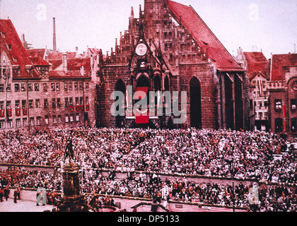Crowd of Spectators Seated in front of Frauenkirche during Nazi Rally, Nuremberg, Germany, 1933 - Stock Photo