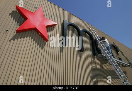 Sep 06, 2006; San Diego, CA, USA; Sign Method Electrical Sign & Neon (from Long Beach) employee Enrique Ramirez - Stock Photo