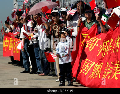 Sep 18, 2006; San Diego, CA, USA; VICENTE LIU, 4, of Tijuana, Mexico, center, holds an American and Chinese flag - Stock Photo