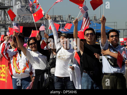 Sep 18, 2006; San Diego, CA, USA; Chinese-Americans hold both flags and greet the the Qingdao, a destroyer, and - Stock Photo
