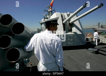 Sep 18, 2006; San Diego, CA, USA; People's Liberation Army (Chinese Navy) sailor ZHANG HONGHUI, center,  watches - Stock Photo