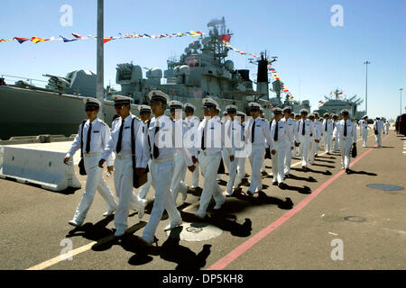 Sep 18, 2006; San Diego, CA, USA; People's Liberation Army (Chinese Navy) sailors head to a tour bus from Pier 2 - Stock Photo