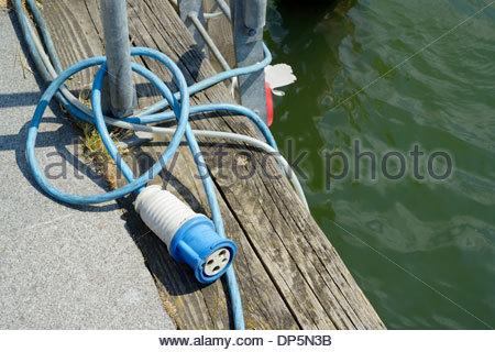 Electric hook up cable on quayside, Poole, Dorset England UK - Stock Photo