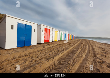 Beach huts in a row on Woolacombe Sands in North Devon, UK. - Stock Photo