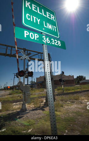Oct 13, 2006; Carl's Corner, TX, USA; Keller, Texas road and population by the railroad crossing sign in the mid - Stock Photo