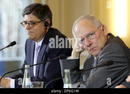 Berlin, Germany. 08th Jan, 2014. United States Secretary of Treasury, Jacob Lew (L), and Germany's Federal Minister - Stock Photo