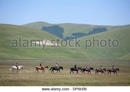 horsemen riding,castelluccio di norcia,umbria,italy - Stock Photo