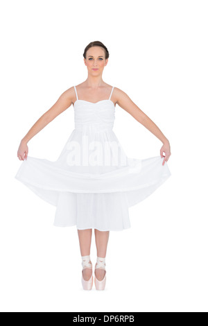 Peaceful young ballet dancer standing on her tiptoes - Stock Photo