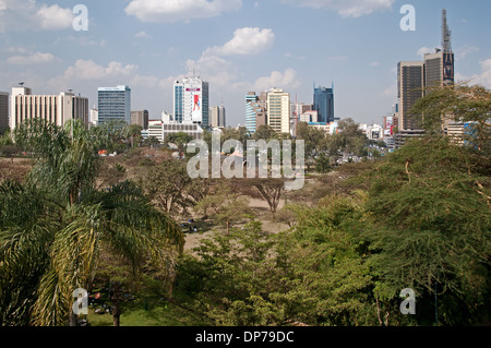 Nairobi city skyline with high rise multi storey buildings seen across Uhuru Park and Nyayo Monument from Nairobi - Stock Photo