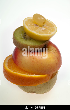Different fruits that are cut into pieces and stacked like a sandwich - Stock Photo