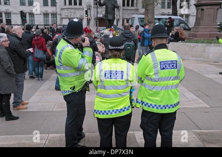 Three Metropolitan Police officers in Parliament Square, London, UK.