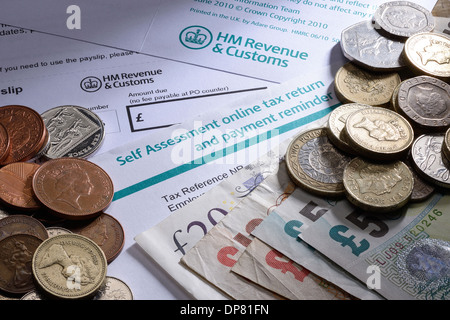 HMRC Self Assessment paperwork with coins and money - Stock Photo