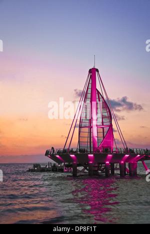 Sail sculpture illuminated at sunset, Puerto Vallarta, Jalisco, Mexico - Stock Photo