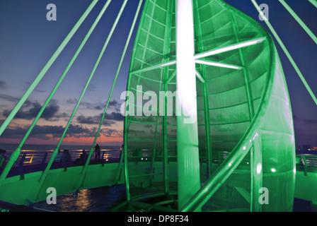 Sail sculpture illuminated at sunset, Puerto Vallarta, Jalisco, Mexico - Stock Photo