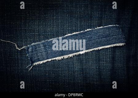 Torn blue jeans texture as copy space, denim texture - Stock Photo