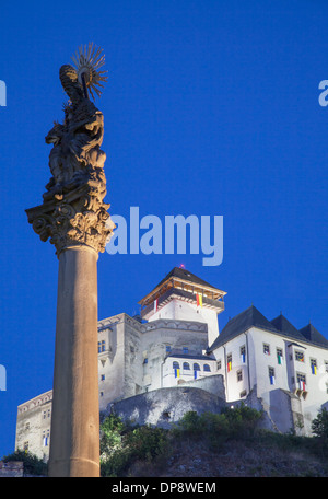 Monument in Mierove Square and Trencin Castle at dusk, Trencin, Trencin Region, Slovakia - Stock Photo