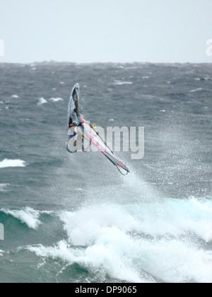 Spanish windsurfer Omar Sanchez, performing an aerial manoeuvre. - Stock Photo