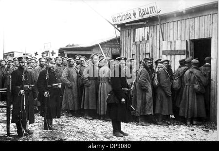 The first Russian prisoners of war stand in a queue in front of the bandage room after their arrival at train station - Stock Photo