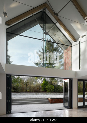 Glass double height entrance foyer in showhome, Highfield, Prestbury, Cheshire, UK. - Stock Photo