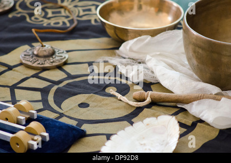 A table-top arrangement around a ying yang of tibetan healing instruments used for holistic healing. - Stock Photo