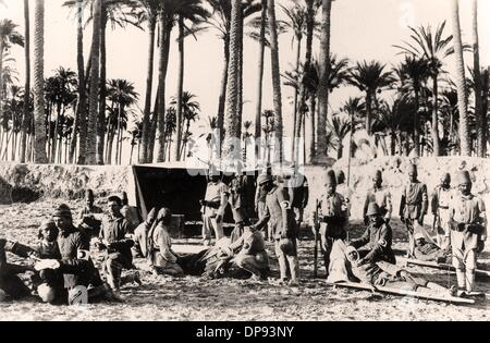 Turkish soldiers take care of wounded soldiers at an aid station on the front in Palestine in 1917. The Sinai and - Stock Photo