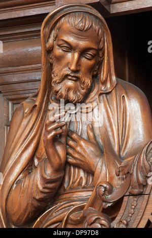 ANTWERP, BELGIUM - SEPTEMBER 6: Carved holy statue in Saint Willibrordus church on September 6, 2013 in Antwerp, - Stock Photo