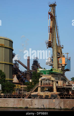 Dock crane at steelworks of ArcelorMittal Gent, world's largest steel producer, port of Ghent, East Flanders, Belgium - Stock Photo