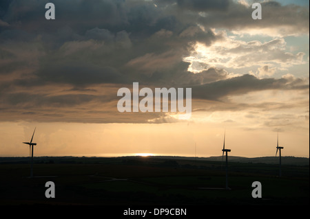 Sunset clouds sky over windfarm wind turbines storm approaching - Stock Photo
