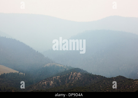 Smoke filled skies from forest fires over the Rocky Mountains, Central Colorado, USA - Stock Photo