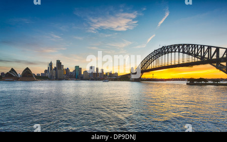 Sydney and Sydney Harbour Bridge at sunset, Australia - Stock Photo