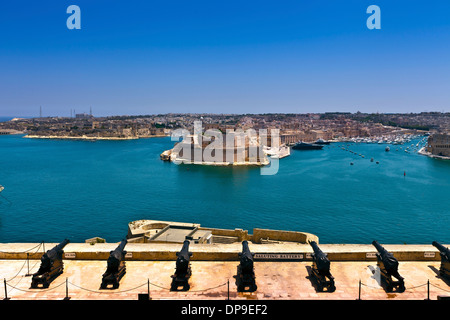 View of the Grand Harbour, Fort St. Angelo and Birgu (Citta Vittoriosa) waterfront, from the Upper Barracca Gardens - Stock Photo