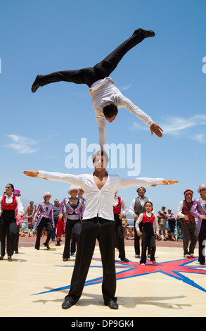 Circus performing near beach in Las Palmas, Gran Canaria, Spain - Stock Photo